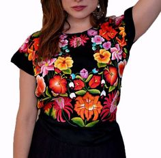 the Tehuana blouse is one of the most valuable Mexican traditional clothing known world wide. Silk threads, velvet, big embroidered flowers, lace, and shiny fabrics are part of the things that give li