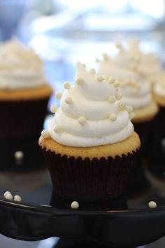 Vanilla cake with Lemon filling, lemon cream cheese icing, white perals. idea #1