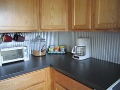Budget Kitchen Update: Corrugated Steel Backsplash or under the bar
