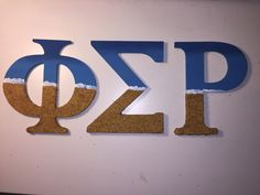 Phi Sigma Rho painted beach letters
