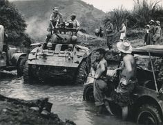 French troops moving alongside a river at Hoa Binh, French Indochina. Most of the equipment was provided by the US to support anti communist forces. Many vehicles came straight from ww2 depots.