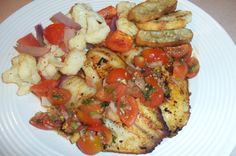 Pan seared tilapia topped with cherry tomato salsa, roasted cauliflower, tomatoes and onions with garlic toast points