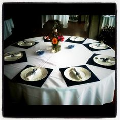 inexpensive wedding idea? Place mats are scrapbook paper, plates are plastic but look real, and all the silverware is DIY