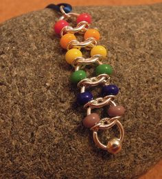 Rainbow Centipede Chain Maille Pendant Would look amazing with pearls  or with same color seed beads