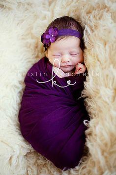 Love the dark purple and her skin complex. Precious!