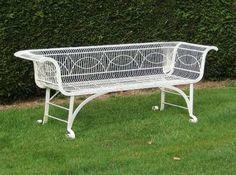 An antique wrought-iron garden bench.