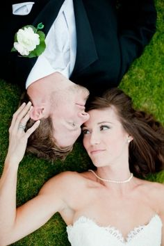 photo of couple laying in grass by irenepo