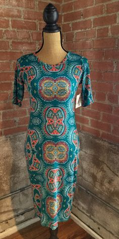The Julia dress is a form fitting, knee- length, knit dress with mid-length sleeves and a high neckline. Its simple silhouette makes the Julia dress a great canvas for layering and accessorizing. This