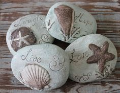 decorative cement rocks come in a set of 4 featuring the engraved words Live, Laugh, Love & Hope along with raised carvings of sea life.  - California Seashell Company