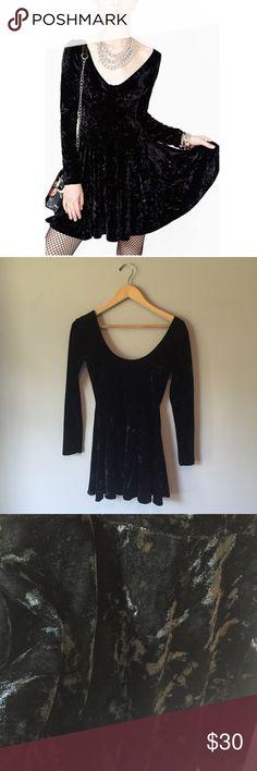 Nast Gal Little Black Velvet Dress 90% polyester 10% spandex. V neck in the front and back, flared skirt. Runs small. Nasty Gal Dresses Long Sleeve
