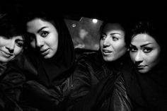 Fabio Bucciarelli - Left to right: Somaye, Anna, Mona and Neda. Iranian girls travelling by an illegal night taxi in Teheran.