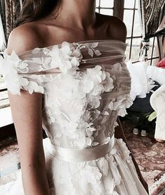 This off the shoulder haute couture wedding gown has beautiful flower art design embellished on the bodice. Have custom like this made to order in a price range you can afford. We also make realy close of haute couture for brides who love the coutu Applique Wedding Dress, Custom Wedding Dress, Dream Wedding Dresses, Bridal Dresses, Prom Dresses, Dresses To Wear To A Wedding, Colored Wedding Dresses, Event Dresses, Modest Wedding