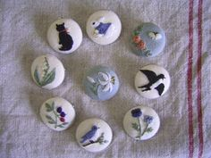 Embroidery buttons. Love the rabbit