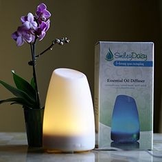 Aromatherapy Essential Oil Diffuser by Smiley Daisy® - Best Electric Ultrasonic Diffuser for Your Scented Oils (Eucalyptus, Lavender, etc.) - Free eReport Download - Best Candle Burner Replacement - Your Purchase Supports Charity - 180-Day Product Replacement Warranty When You Purchase with Smiley Daisy (White), http://www.amazon.co.uk/dp/B00GOJDD14/ref=cm_sw_r_pi_awdl_x_cDg2xbPNWDEWJ