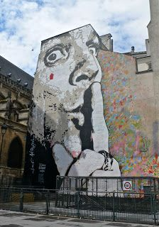 """4th arrondissement - famous for its street art and wall murals.  This one is called """"Chuuut"""".  Chut is the French way of saying """"shush""""."""