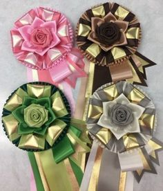View our collection of ribbons and rosettes available in accents including floral, patterned, glittery golds, silvers and more. Satin Ribbon Roses, Ribbon Rosettes, Ribbon Making, How To Make Ribbon, Horse Show Ribbons, Mums The Word, Birthday Pins, Homecoming Mums, Corsages