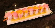 It's HOT out there! Seems like the perfect time to enjoy some Summer Lovin'! Shrimp tempura, spicy tuna, krab mix, & cream cheese, yellowtail, mandarin oranges, and orange ginger vinaigrette, wrapped in soy paper #sushi #food #summer
