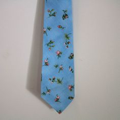 A heavenly blue tie with a soft pink floral print.  One of a kind.