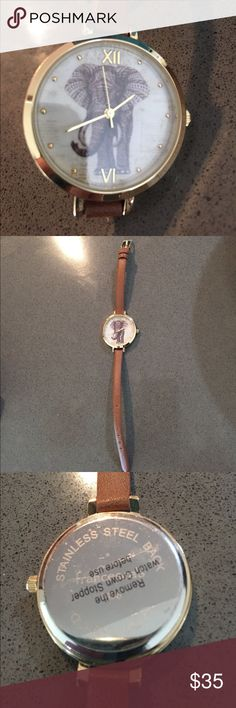 Elephant watch. 🐘 Gold watch with elephant face, skinny brown strap, never worn.  Fully working, has new battery. Francesca's Collections Accessories Watches