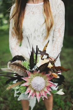 boho bouquet with king protea and feathers