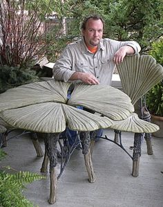 "Ross Yedinak with his gingko bistro set, made in the style of ""faux bois,"" or false wood, in which cement is layered on a galvanized steel frame and sculpted to resemble wood."
