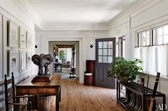 In a Martha's Vineyard home designed by Mark Cunningham, a potted peppermint-scented geranium adds a dash of color to the entrance hall.