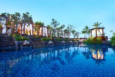 """The St. Regis Bali is nestled in the heart of the noteworthy """"Garden of Bali"""". Captivating in every detail, the beautifully appointed suites and villas welcome guests with all the comforts of a contemporary refined Balinese home.  Truly feel like a VIP when you book with Travel with Terra and get these Exclusive Terra Perks **60 Minute Aqua Vitale Treatment for two, per room, per stay and a classic Afternoon Tea for two at King Cole Bar, once during stay**"""