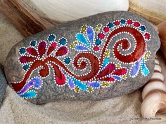 everlasting. forever and always. free spirit. Painted rock (sea stone) from Cape Cod.  A beautiful, soft gray stone, worn smooth over time being tumbled in the sea.  The colors on this sea stone are reddish sepia, turquoise, lilac, barn red, rose, citron and white in layers of water resistant glaze inks over paint. This stone has a calming, grounding weight when held. Come now...gently extend your hand... place it in your palm.... ahhh... yes...now that is better....  This stone would be…
