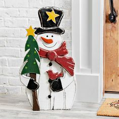 Wooden Snowman With Tree Outdoor Statue, 30 in. from Kirkland's Outside Christmas Decorations, Christmas Yard Art, Christmas Wood Crafts, Christmas Snowman, Rustic Christmas, Christmas Projects, Outdoor Snowman Decorations, Primitive Christmas, Christmas Signs