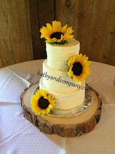 Rough lined buttercream wedding cake with fresh sunflowers.