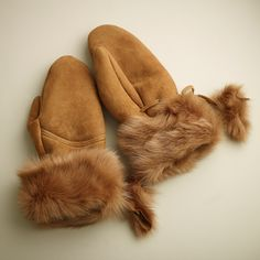 The ultimate in cozy, warm gloves. These sheepskin handmade mittens are ultra cute and amazingly warm.