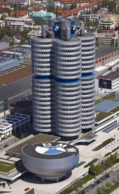 BMW Headquarters in Munich (photo by Diego Delso/Wikimedia) - Opened in 1973, BMW's Munich headquarters was designed by architect Karl Schwanzer to mimic the shape of the company's four-cylinder engine. A cylinder head alongside it holds a museum.