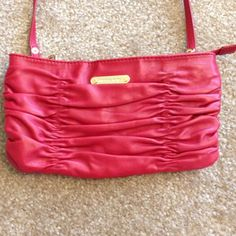 """HPx2 MK Ruched Clutch Bag - NWOT Red ruched leather clutch bag from Michael Michael Kors. Long shoulder strap, a top zip-up fastening, an internal zip fastening compartment and multiple interior pockets. 100% Leather. Measures about 5.5""""H x 10""""W. Removable strap. *SEE PICTURE 4 for a minor imperfection* I received this as a gift - I believe it was purchased at an outlet because the price is written in ink on the inside zipper pocket. No trades, no PayPal. MICHAEL Michael Kors Bags Clutches…"""