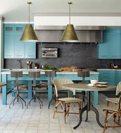 It's not surprising that Bobby Flay's Hamptons kitchen has a commercial 10-burner stove, two Viking ovens, a fryer, griddle, salamander, and seating that includes a farm table and two café tables. (He is a professional chef and TV star, after all.) But what is surprising is the color choice — a beautiful turquoise blue that is such a lovely change of pace from the all-white kitchens we're used to seeing.
