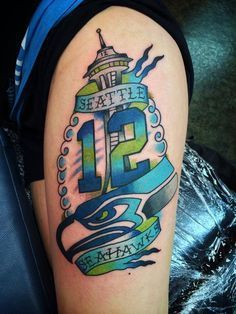 Seattle Seahawks 12th man with space needle tattoo