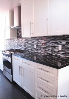 Amazing Modern and sleek kitchen remodel with before and after pictures. They transformed a dated kitchen into this gorgeous modern kitchen! White Kitchen Decor, Kitchen Redo, New Kitchen, Kitchen Ideas, Kitchen Backsplash, Kitchen Black, Awesome Kitchen, Kitchen Modern, Backsplash Ideas