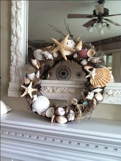 Make this beautiful natural seashell wreath. It's easy and I love the rustic look. I used a grapevine wreath, assorted seashells (some I found on the beach), hot glue gun, Spanish Moss, and raffia. Hint, when using the hot glue gun be very careful...they are really hot! Place your shells in different directions and hot glue the surface that will be touching the wreath. Tuck in and glue the Spanish Moss to the wreath. (I did the big pieces first). It's Fun!