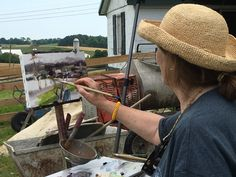 Anne painting on the Homestead farm during the Barnstormers Tour