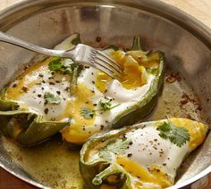"""Eggs in Pepper Boats Recipe - Jacques Pepin - """"One day I decided to cook eggs in sweet peppers with a bit of cheese and cilantro. It made a great lunch dish. I used the long, pale green peppers sometimes called banana peppers. Poblano and cubanelle peppers also work, especially if you want to add a little heat."""""""