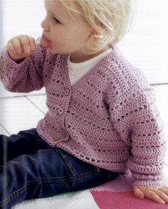 She looks so cute in this crochet cardigan