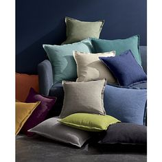 Hand-dyed yarns are woven for a richly heathered, tone-on-tone coloring with the look of textured grasscloth. Double open flange and generous size cushions in casual comfort, perfect for lounging and scrunching. Our decorative pillows include your choice of a plush feather-down or lofty down-alternative insert at no extra cost.