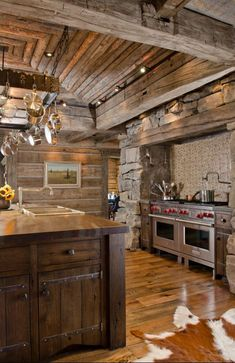 Elegant rustic cabin kitchen with a touch of cowhide!