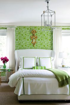 Love the brightness of the walls, but not so sure I'd want to stick to a tight color palatte, which is a must with the bright walls. BUT, a huge frame of the green stencil would be awesome! AND love the cushiness of the headboard. Luxury feel.