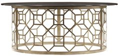 Looking for a glamorous focal point for your living room? Look no further than our Roxy Glass Cocktail Table. Combining metal and glass the table is a style knockout. Linking octagons create the circular basis which is then topped with a tempered glass top with a polished edge. The rounded shape serves as a focal point inviting friends and guests to the conversation while it softens the metal and glass duo for a design that is as attractive as it is welcoming.