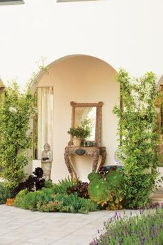 Marg Helgenberger's home. The loggia's furnishings evoke golden-age Hollywood glamour while a burst of succulents is in keeping with the home's Mediterranean style.