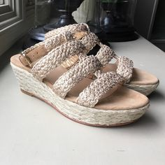 Stuart Weitzman - Haiti Crochet Jut Wedge Gold This all over crocheted jute sandal from Stuart Weitzman has a made for summer appeal. Crocheted Jude upper with three bands across front. 2 1/2 inch Jude wedge heel; 1 inch platform; 1 1/2 inch total height. Round open toe. Adjustable ankle strap. Leather footbed. Made in Spain Stuart Weitzman Shoes Wedges