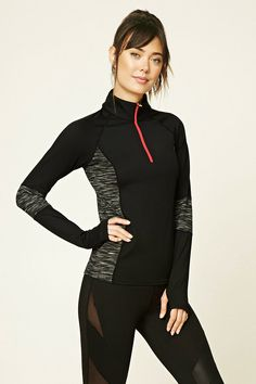 A stretch-knit athletic pullover featuring a partial zip-up front, long sleeves, zippered pocket in back, thumb holes, and heathered colorblocking on the sleeves and sides.
