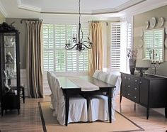 Example of swing arm curtain rod - can be used with drapes in lieu of one long, wide rod so that focus is not on open curtain rod.