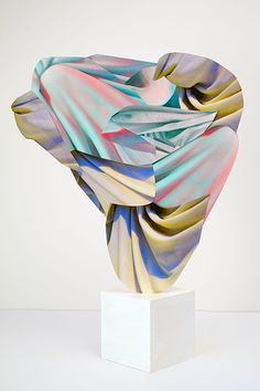 I make fictional sculptures expressly in order to photograph them. The photograph, rather than the object, is the final product. I make the objects, which are flat, from pieces of photographs that are in large part sourced from other sculptures. The constructions rely on the three-dimensionality depicted in these fragments to create the illusion of a sculptural object....