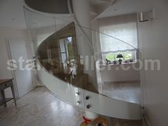 curved glass railing at residential project in Germany www.stairs-siller.com